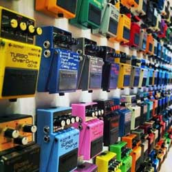 Wall of guitar pedals