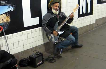 Busker playing electric guitar
