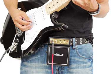 Mini guitar amp clipped on belt
