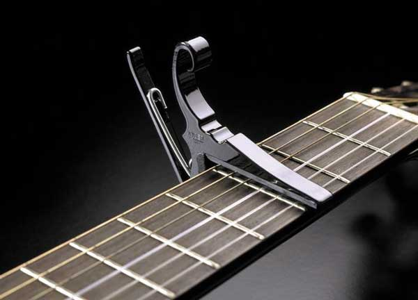 Guitar capo on strings