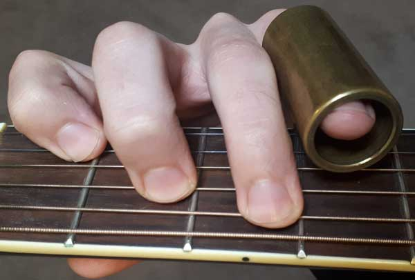 Guitar chord with slide on finger