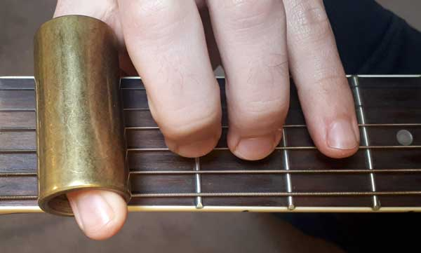 Guitar slide on first finger