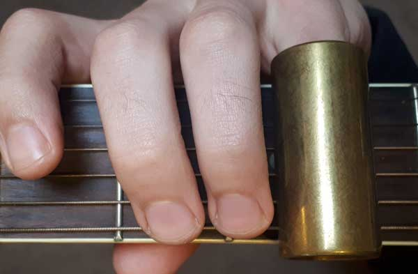 Guitar slide on fourth finger