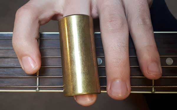 Guitar slide on second finger