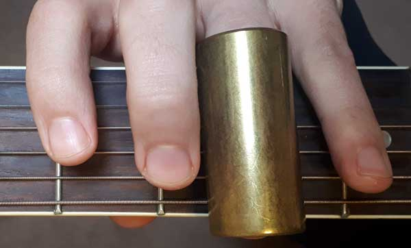 Guitar slide on third finger