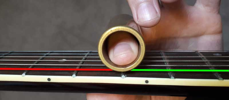 Guitar string vibrating with guitar slide