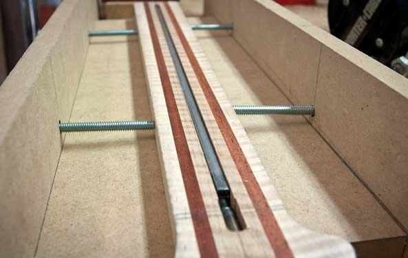 Truss rod installed in channel