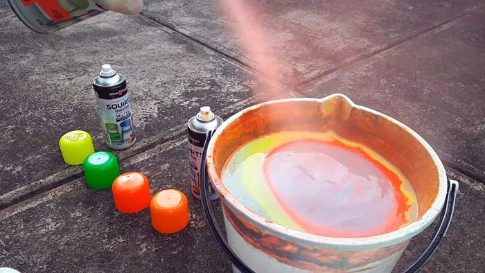 Spraying paint on water